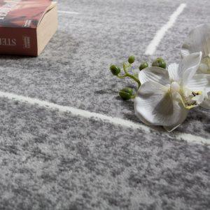 alfombras grises